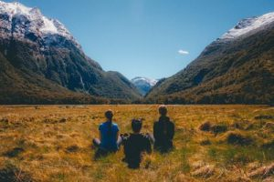 3 meditators in mountain